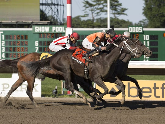 Girvin, ridden by Robby Albarado (outside), wins the