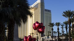 10/3/17 7:34:03 AM -- Las Vegas, NV, U.S.A  --  Las Vegas Police block the streets near Mandalay Bay hotel where some residents put balloons and flowers in the memory of victims in Las Vegas, Nev. on Oct. 2, 2017. Photo by Nick Oza, Gannett