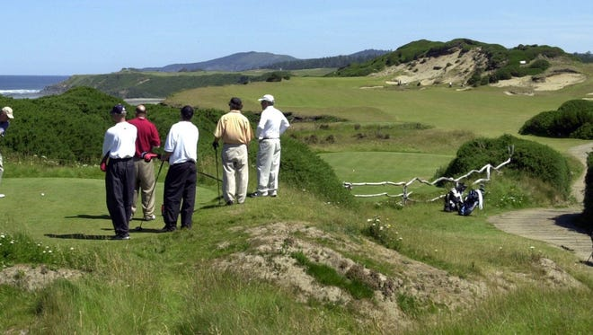 Golfers prepare to tee off at the 13th hole of the Pacific Dunes course at the Bandon Dunes Golf Resort outside Bandon, Ore, June 8, 2005.