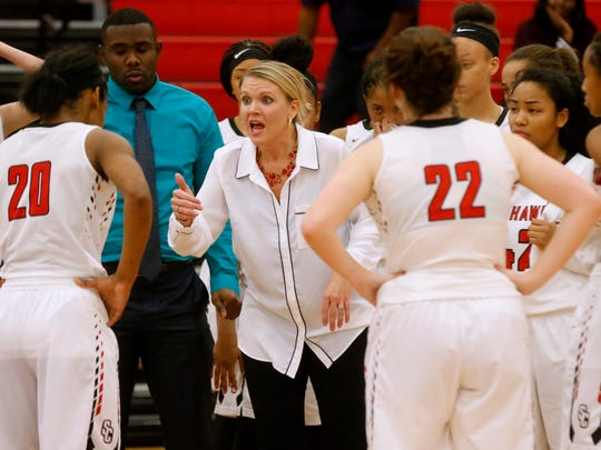 Stewarts Creek coach Lindy King talks with players during Tuesday's 49-35 win over Wilson Central.