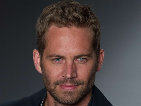 American actor Paul Walker presents a creation by Colcci during the 2013 Summer collections of the Sao Paulo Fashion Week in Sao Paulo, Brazil, on March 21, 2013.