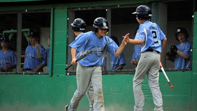 South Burlington's Nolan Antonicci, right, congratulates a teammate who scored during the state championship game against Brattleboro.