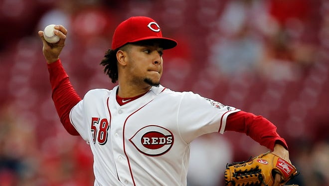 Cincinnati Reds starting pitcher Luis Castillo (58) delivers a pitch in the top of the first inning of the MLB National League game between the Cincinnati Reds and the Milwaukee Brewers at Great American Ball Park in downtown Cincinnati on Wednesday, May 2, 2018.