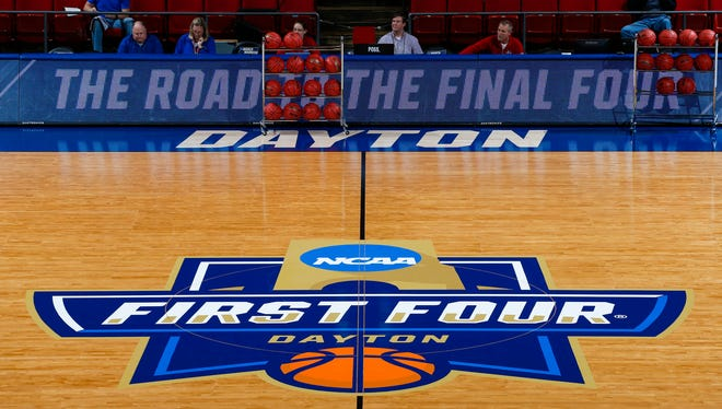 General view of the logo on the court during a practice day before the First Four of the NCAA men's college basketball tournament at Dayton Arena.