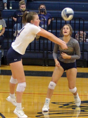Stephenville's Jaydi Griffin (14) sets up a shot as teammate Cali Carter stands by during a recent volleyball home game for the 12th-ranked Honeybees.