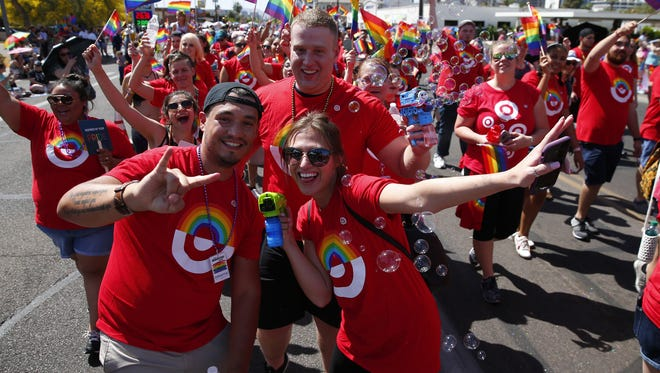 Workers from Target march during the Phoenix Pride Parade in Phoenix April 8, 2018.