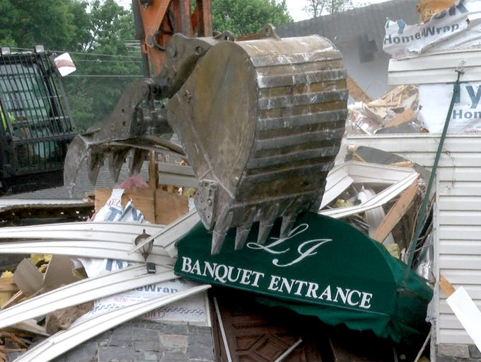 Demolition of the Lincroft Inn is underway on Wednesday