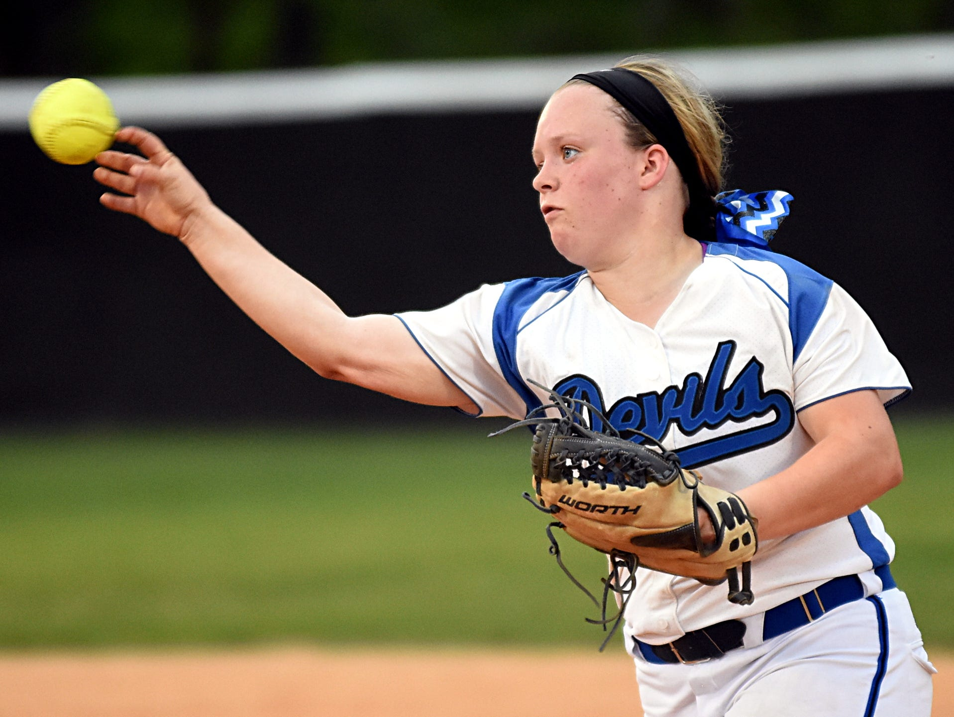 White House High freshman Copelynne Whitaker throws to first base for a fourth-inning putout. Whitaker drew a base on balls and drove in a run with a sacrifice fly.