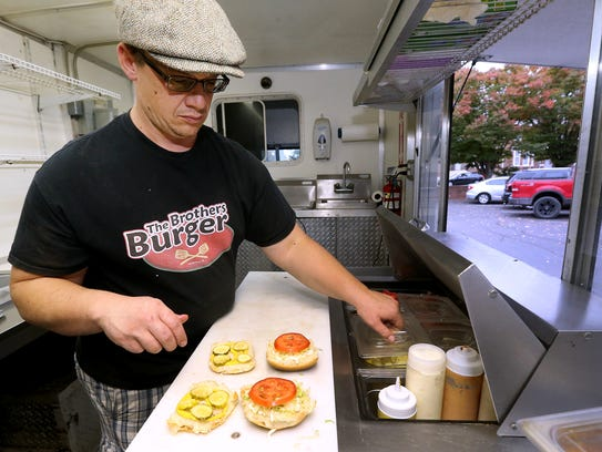 Jeremiah James dresses the buns for the Uncle Sam burger