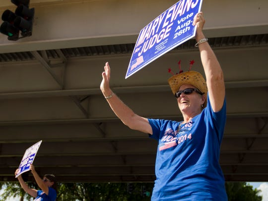 Nancy Campbell, right, and Carla Solazzo campaign for Mary Evans on Tuesday in Fort Myers.