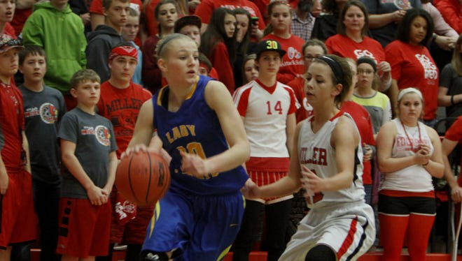 Drury signee Lexie Vaught (left) scored 20 points for Crane in a 67-35 win over Miller March 2 at Nixa High School.