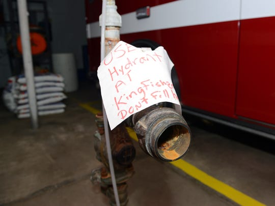A sign is taped to the Frazeysburg fire station's water pump to remind firefighters to fill up the department's trucks and tankers at a fire hydrant to avoid being billed by the village.