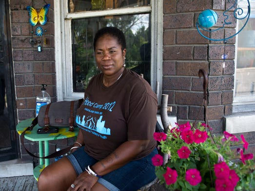 Shamayim Harris, better known as Mama Shu, sits on