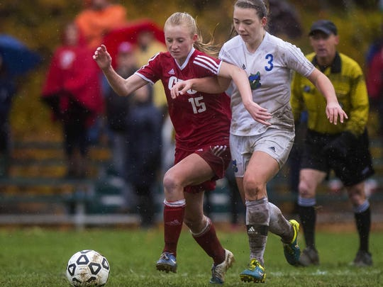 Colchester's Clara Johnson, right, and Champlain Valley's Sierra Morton fight for the ball during Wednesday's Division I girls soccer semifinal in Colchester.