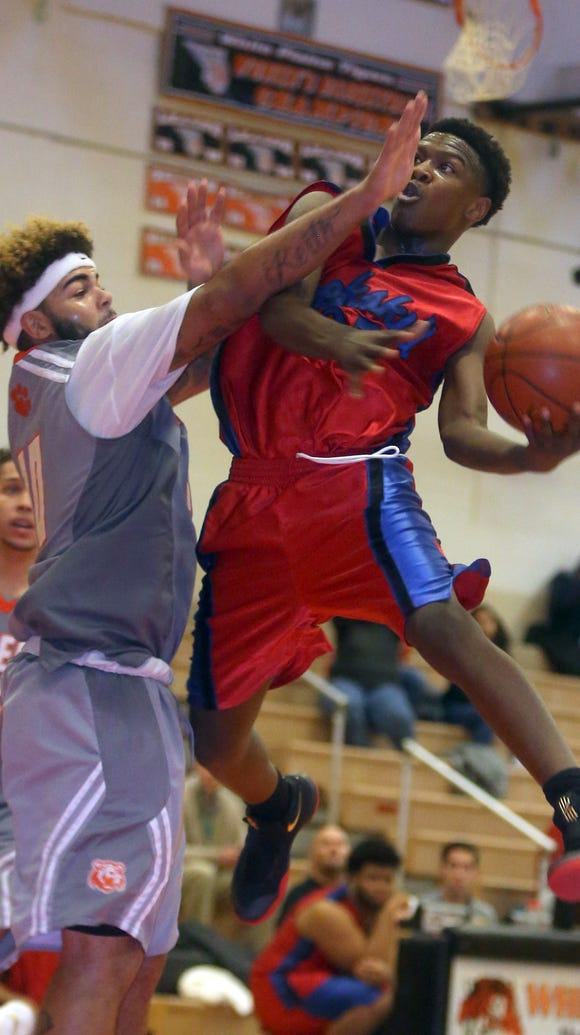 Peekskill's Shion Darby drives on Spring Valley's Devan