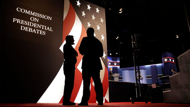 Producers stand next to the stage for the presidential debate between Democratic presidential candidate Hillary Clinton and Republican presidential candidate Donald Trump at Hofstra University in Hempstead, N.Y., Monday, Sept. 26, 2016.