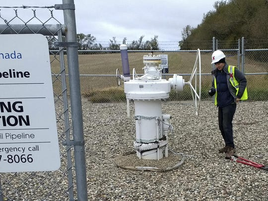 Climate change activist Michael Foster, of Seattle, turns an emergency shut-off valve on an oil pipeline in northeastern North Dakota on Oct. 11, 2016. Foster was arrested and ended up spending six months in jail.