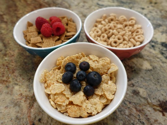 Choose cereals like Special K (foreground), Chex and Cheerios, all which 4g of sugar or less per serving. Fresh fruit adds natural sweetness.
