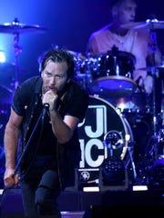 Pearl Jam, featuring, Eddie Vedder, left, and Matt