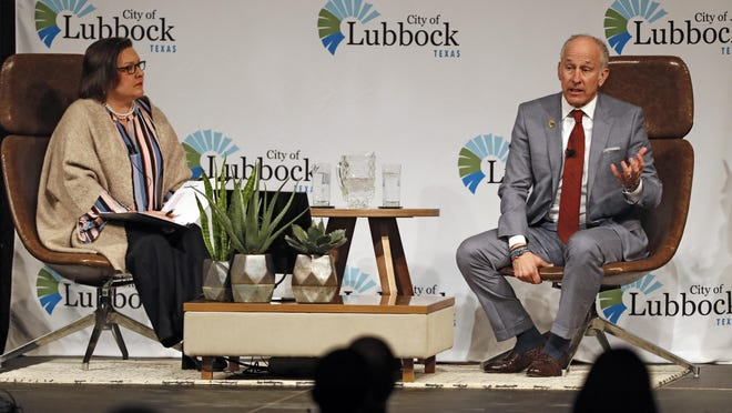 Lubbock mayor Dan Pope talks with Laura Vinson during the State of the City address Jan. 19 at Lubbock Memorial Civic Center in Lubbock, Texas.