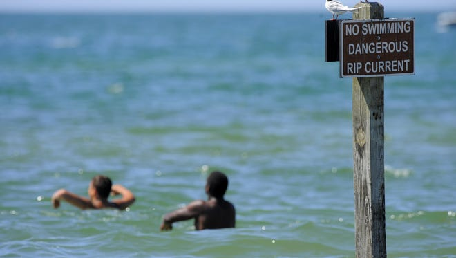 Swimmers are warned of rip currents along the shores of Lake Michigan at Holland State Park. Bob Pratt of Great Lakes Surf Rescue Project says the north-south wind patterns along the parallel shores of Lake Michigan increases waves and creates treacherous waters.