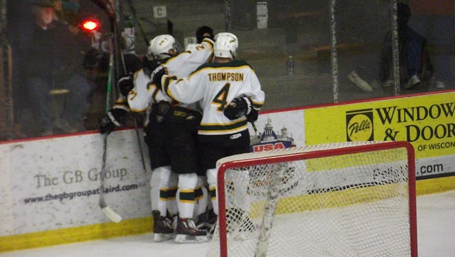 St. Norbert College men's hockey players celebrate a power-play goal by Michael Hill in the first period of a NCHA game against Adrian College on Saturday.