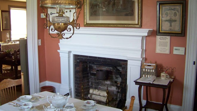 A view of a fireplace inside the historic Tinker Homestead located in Henrietta.