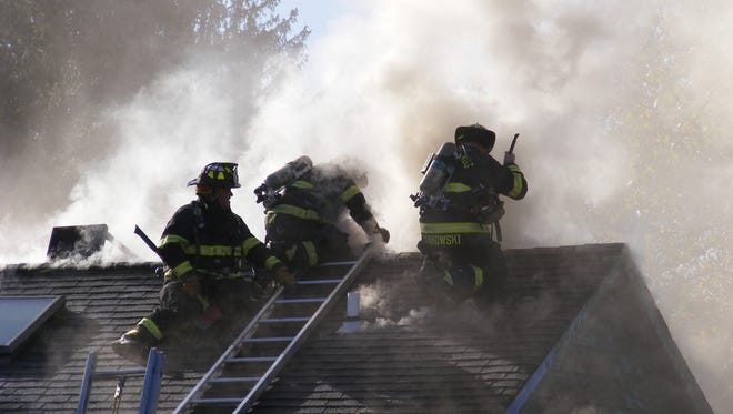 Paramus fire fighters battling a multiple alarm fire at Denny Wiggers Landscaping in Paramus, NJ on Monday morning November 14, 2016. The structure involved was declared uninhabitable due to fire, smoke and water damage.  All occupants safely evacuated the building prior to the arrival of fire department personnel.