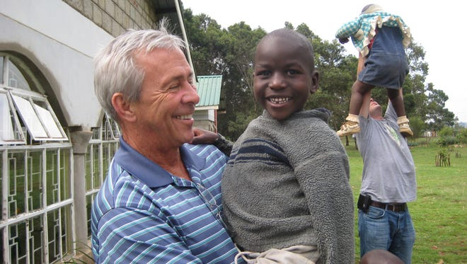 Dr. James Lemons, a neonatologist at IU Health, visits an orphanage in Kenya. He serves on the board of The Power of One, a nonprofit that makes small grants to Indiana charities working to improve life for people around the world.