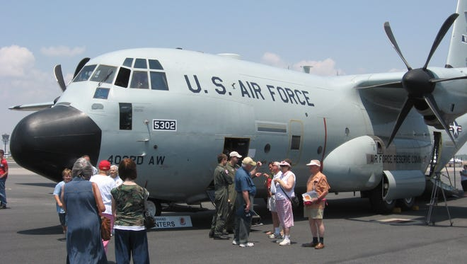 An Air Force 53rd Weather Reconnaissance Squadron Hurricane Hunters aircraft sits at Pensacola Regional Airport.