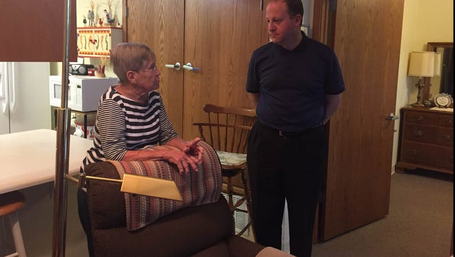 Caption: Meg Ross, resident of the Sanctuary Place apartments in Fort Collins, shows Congressman Jared Polis, D-Colo., around her apartment on Monday, Aug. 14, 2017. Ross was among 28 residents who sent letters to Polis urging him to advocate against cuts to HUD's 202 program, which helps seniors at the Sanctuary Place Apartments afford to their rent.