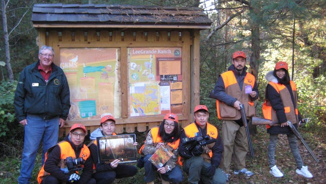 A group of grouse hunters enjoy the land set aside by the state with the GEMS program for grouse habitat.