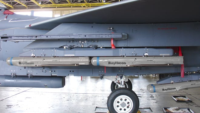 Raytheon's SDB II small diameter bombs are shown on an F-15E fighter aircraft. The jet can carry seven groups of four of the SDB II bombs, for a total of 28 weapons. National Presto in Eau Claire has landed a subcontract to build warheads for the U.S. Defense Department's Small Diameter Bomb Program.