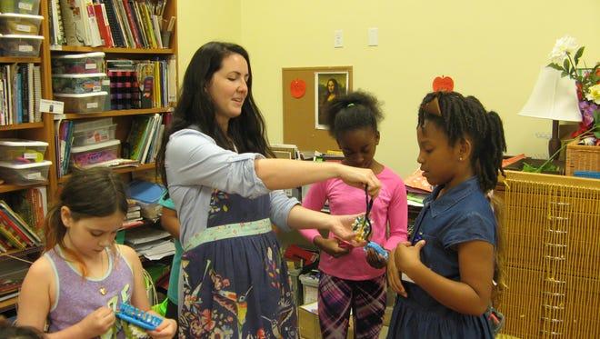 Art teacher Heather Light doles out yarn and community spirit.