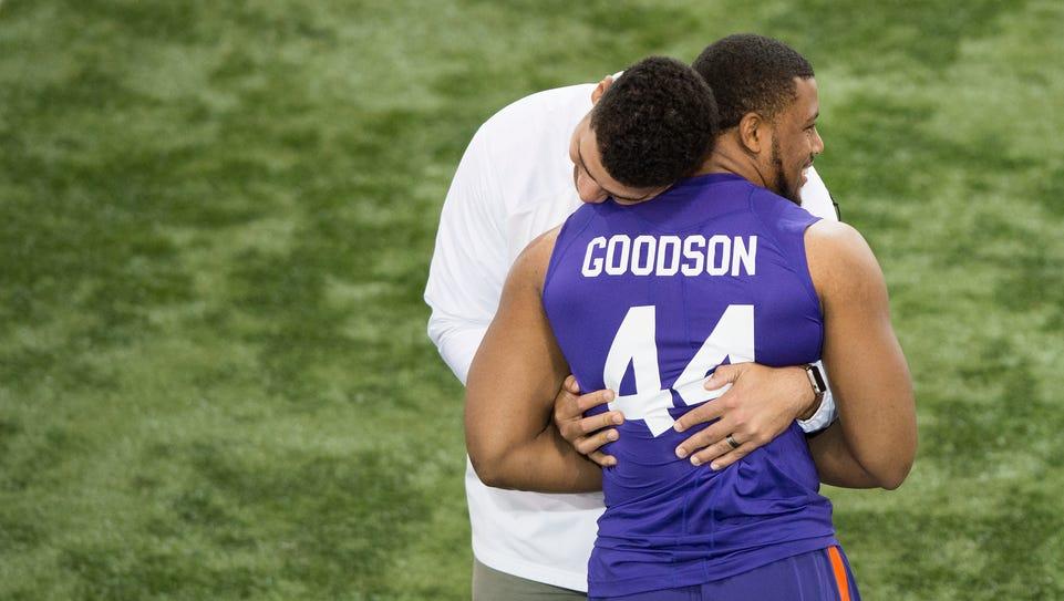 Linebacker B.J. Goodson receives a hug during Pro Day