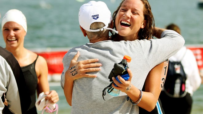 KINFAY MOROTI/THE NEWS-PRESS ... Stephanie Peacock celebrates winning the Second Annual Fran Crippen 10K Cup open-water race Saturday (3/28/15) at Miromar Lake on the FGCU Waterfront in Estero. Peacock is a graduate of Bishop Verot High School and the University of North Carolina.