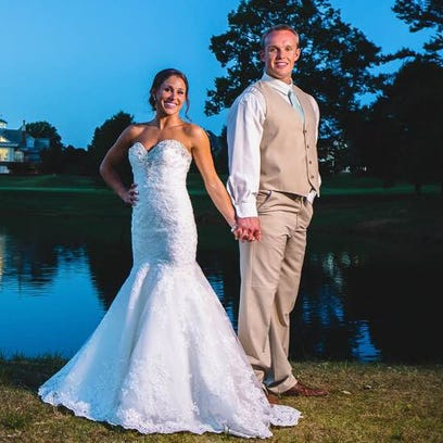 Louisville punter Josh Appleby and his wife, Leslie,