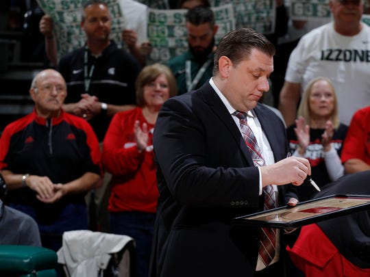 Southern Utah coach Todd Simon, a Fowler native, draws up plans in front of the bench before a game against Michigan State, Saturday, Dec. 9, 2017, in East Lansing, Mich. In the background at left are his step father Gene George and mother, Aggie George.