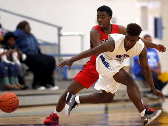 West Oso's Larry Hamilton reaches for the loose ball against Wharton's BJ Baylor during the Regional IV-4A Semifinal game on Friday, March 3, 2017, at the Steinke Physical Education Center in Kingsville.