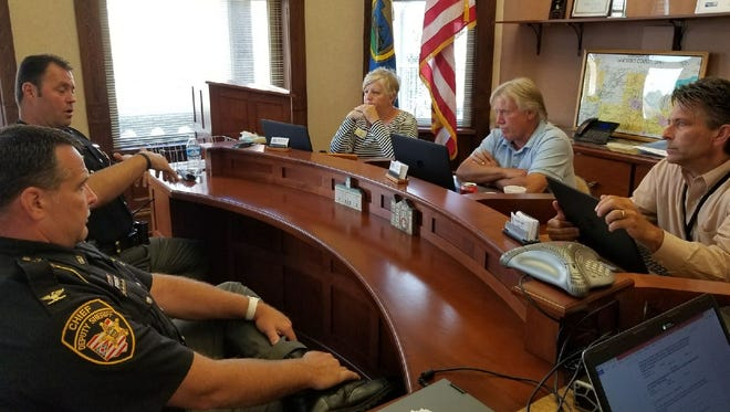 From left, Sandusky County Sheriff Chris Hilton and Chief Deputy Ed Hastings meet with Sandusky County Commissioners Kay Reiter, Charlie Schwochow and Scott Miller.