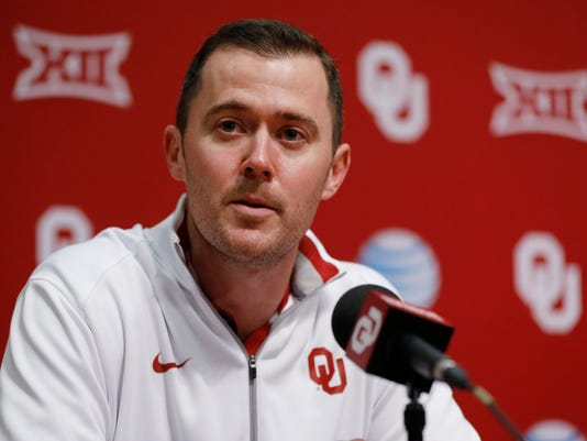 Lincoln Riley, Oklahoma's new offensive coordinator, answers a question during an NCAA college football news conference in Norman, Okla., Saturday, Jan. 17, 2015. (AP Photo/Sue Ogrocki)