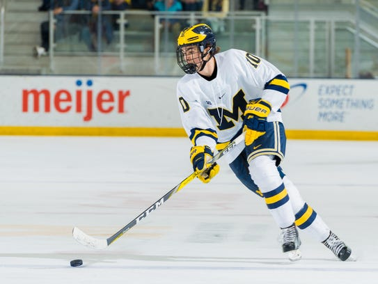 Carrying the puck during a recent U-M game is Will