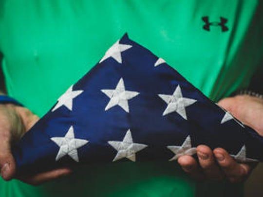 Retired Staff Sgt. Rodney Dean Kerksieck holds a folded