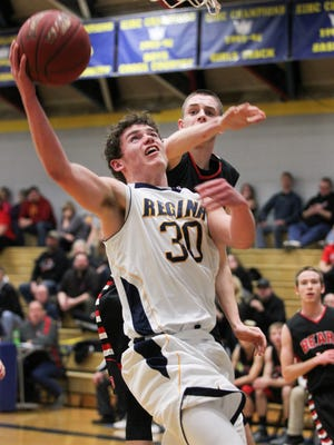 Regina's Jacob Phillips goes up for a shot during the Regals' game against West Branch at Regina on Tuesday, Feb. 2, 2016.