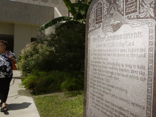 A monument with the Ten Commandments listed sits on