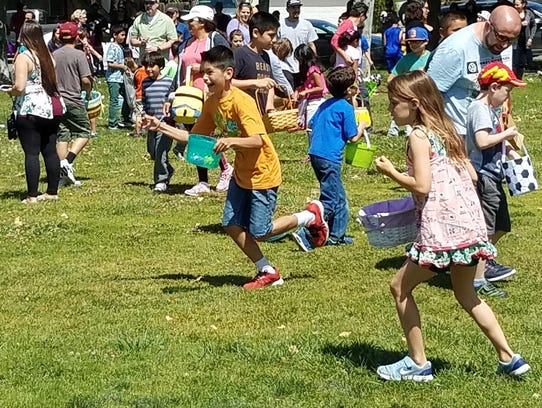 Children rush to find eggs during the 2017 Easter Eggstravaganza