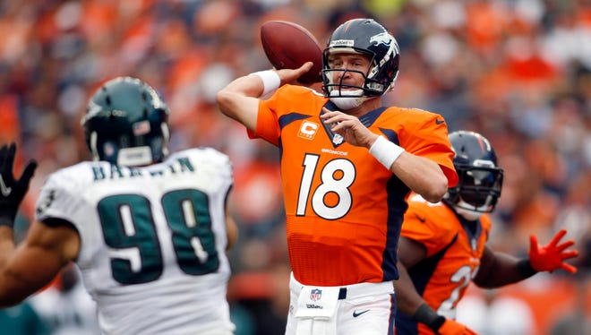 Denver Broncos quarterback Peyton Manning (18) throws the ball during  the second half against the Philadelphia Eagles at Sports Authority Field in Denver on Sept. 29, 2013.