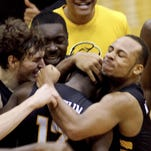 Southern Mississippi celebrates after a come-from-behind 63-60 victory over UTEP in an NCAA college basketball game in Hattiesburg, Miss., Saturday, Feb. 28, 2015. (AP Photo/George Clark)