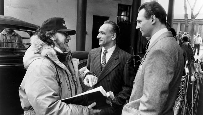 """Spielberg, left, on the Poland set of """"Schindler's List"""" with Ben Kingsley and Liam Neeson in 1993."""