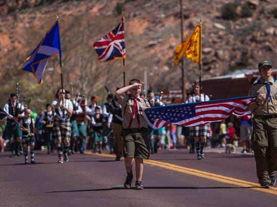 Boy scouts lead the St. Patrick's Day parade in Springdale by carrying the American flag, Saturday, Mar. 19, 2016.